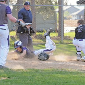 Boyceville's Walker Retz safely slides home versus Durand