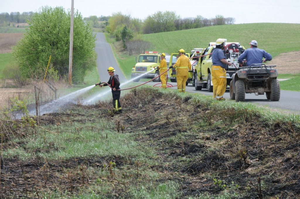 GLENWOOD CITY Firefighters worked to extinguish a small grass fire in a ditch along 290th Street in the Town of Glenwood Thursday afternoon, May 10. —photo by Shawn DeWitt