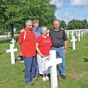 VISIT UNCLE'S GRAVESITE at military cemetery in France. Don Klatt, Paula DeWitt, Allen Klatt, and Corey Klatt visited their uncle and great uncle Helmer Alseth's grave. He was killed in action in World War II.