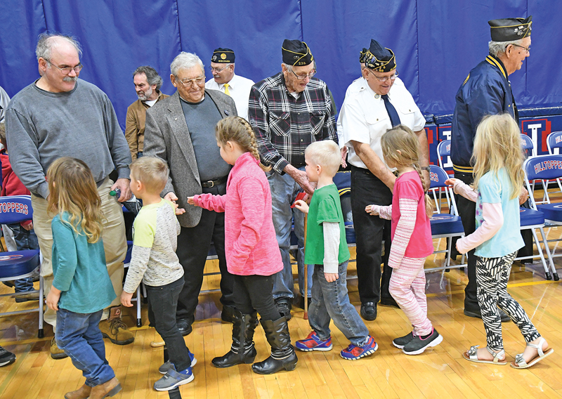 THANKING A VETERAN — At the conclusion of Monday's Veterans' Day ceremony at Glenwood City High School, students took the opportunity to shake hands and thank the area veterans in attendance for their service to the USA. —photo by Shawn DeWitt