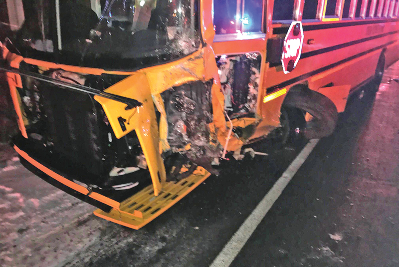 AN AMERY SCHOOL BUS showed damaged to the front driver side after it was struck by a Rice Lake man, who was pronounced dead at the scene. The bus was carrying the Amery girls' basketball team when the crash occurred. —photo submitted