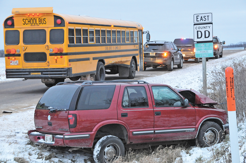 MINOR INJURIES were reported when a Glenwood City School Bus and a Chevy Blazer collided at the intersection of County Highways D and DD Monday afternoon, November 12 around 4:10 p.m. in the Town of Springfield. According to the St. Croix County Sheriff''s Office which investigated the accident. The school bus, which was being driven by Bob Darwin of Glenwood City, was eastbound on County Road DD and had stopped for a stop sign at the intersection with County Road D. According to the report, Darwin then proceeded into the intersection and was struck on the right side by a northbound 1998 Chevy Blazer being driven by Gregory Olson of Woodville. The Olson vehicle came to rest in the southeast ditch corner of CTH D and DD. Olson, who had to be extricated from his vehicle by Glenwood City Firefighters, received minor injuires but refused medical attention and transport. Neither Darwin nor any students that were on the bus at the time of the incident were injured. The St. Croix County Sheriff's Office is still investigating and may issue citations at a later date. —photo by Carlton DeWitt