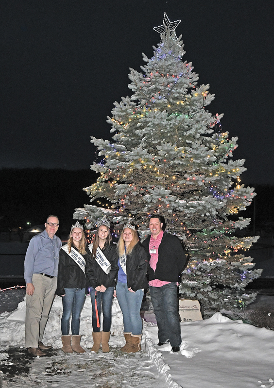 DOING THE HONOR of lighting the 2018 Glenhaven Auxiliary's Chirstmas Care Tree this past Sunday, December 2 were members of Glenhaven's administration, board and the current Miss Glenwood City court. From left to right are: David Bartz, Glenhaven board president; Alexa Holden, first princess; Bethany Ullom, Miss Glenwood City; Kaitlin Lee, second princess; and David Prissell, Glenhaven administrator. —photo by Shawn DeWitt