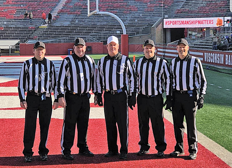 FOOTBALL CREW: The Colfax football crew refereed a state championship game at Camp Randall Stadium in Madison November 15. From left: Travis Logslett, Tim Prince, Rick Prince, Jeff Prince and Clark Yolitz. —photo submitted