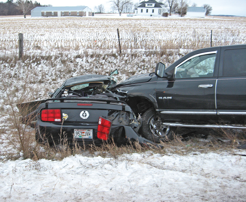 FATAL COLLISION — A 44-year-old Menomonie woman, Amy Lynn Kahl, lost her life Monday morning, December 3 when the 2006 Ford Mustang (shown on the left) she was driving crossed over the centerline and was struck by a 2008 Dodge Ram pick-up driven by 33-year-old Plum City woman, Jessica Marie Bauer, who was not injured. The accident happened at 6:45 a.m. on State Highway 25 just north of 420th Street near Menomonie. 					 —photo by the Wisconsin State Patrol