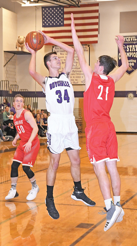 BOYCEVILLE'S POST PLAYER Cade Klefstad got this frist-half shot over Colfax defender Ed Hydukovich to falll for his only points in the game. Boyceville eventually fell at home to the Vikings, losing last Friday's contest by 48 points. —photo by Shawn DeWitt