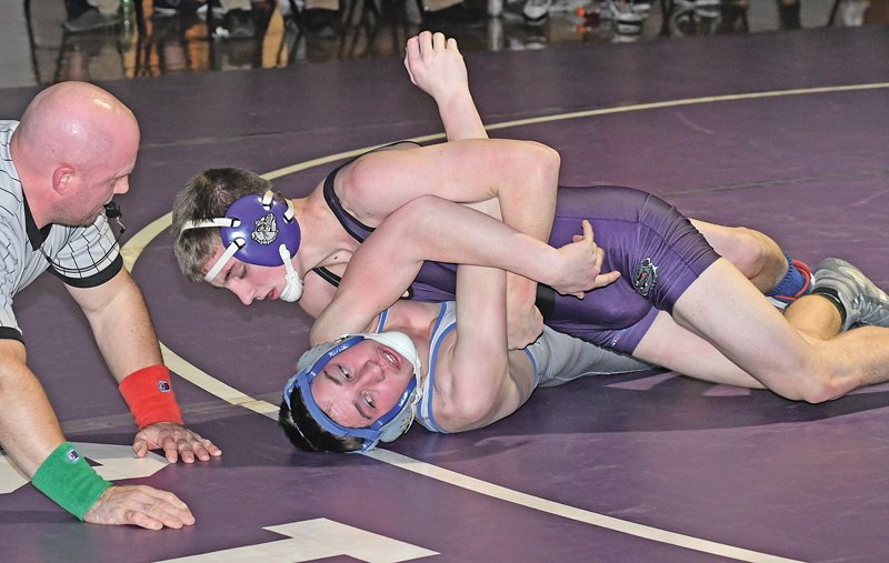VICTORY WRAPPED UP — Bulldogs' freshman Tyler Domanen (top) is shown scoring back points against his Mondovi oppoent, Lance Crawford, in the 138-pound match of last Thursday's Dunn-St. Croxi dual in Boyceville. Dormanen scored the pin at 5:12. —photo by Shawn DeWitt