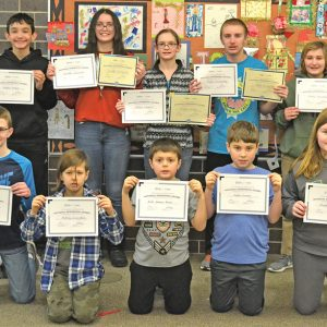 COLFAX ELEMENTARY GEOGRAPHY BEE — National Geography Bee grade level winners posed with their certificates January 15. Bottom row from left: Charlie Charbonneau (5th grade, first place grade level); Matvey Zazovskiy (5th grade, second place grade level); Andre Naranjo-Rivera (4th grade, first place); Hayden Sarauer (4th grade, second place); Shyann Rundle (6th grade, second place). Back row from left: Grayson Decker (7th grade, second place); Jeanette Hydukovich (7th grade, first place grade level, first place overall); Allison Schmitt (8th grade, first place grade level, second place overall); Mark Sonnentag (8th grade, second place grade level, third place overall); Rosie Sonnentag (6th grade, first place grade level). —photo by LeAnn R. Ralph