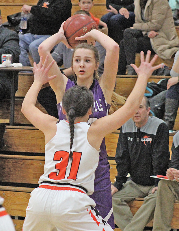 LOOKING FOR anyone to get the pass off to, Kady Grambow (#23) keeps the ball out of reach from defender Hailey Blaskowski (#31) in the first half. —photo by Amber Hayden