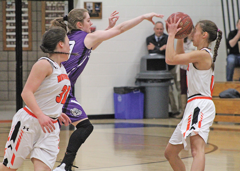 RIGHT SPOT RIGHT TIME— Elk Mound's Brook Plaszcz (#11) stepped up at the right time to catch the pass from Boyceville's Rachel Prestrud (#10) during last Thursday evening's win. —photo by Amber Hayden
