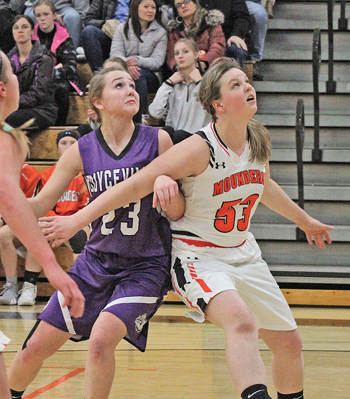 BLOCK OUT— Kayla Bridges (#53) blocks Boyceville player Kady Grambow (#23) during a Boyceville trip to the foul line. Bridges finished the evening with six points for Elk Mound. —photo by Amber Hayden