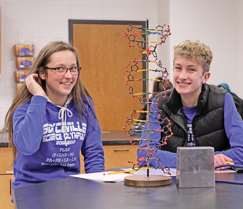 Boyceville Science Olympiad team mates Emma Bygd and Mark Timper finished up one of the many stations they had to do in the event called Designer Genes. The duo earned a gold medal. —photo by Steve Duerst