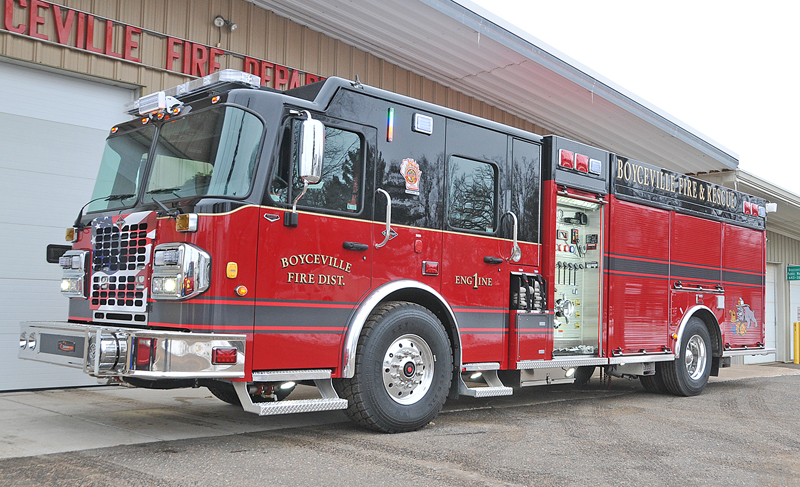 "BOYCEVILLE'S NEW FIRE ENGINE arrived last week to the delight of all local firefighters. The unit, which replaces a 27 year old engine is designed to not only to carry all needed fire fighter tools and equipment but also a full compartment of rescue equipment including the ""Jaws of Life"". The engine boosts an 2,000 gallon per minute water pump and carries 1,000 gallons of water. Members of the department are planning an open house in the spring to allow the public to view the new unit. —photo by Carlton DeWitt"