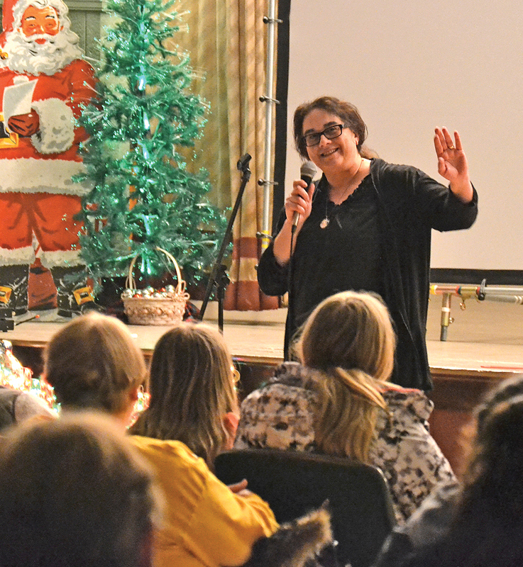 Lisa Bragg-Hurlburt, director at the Colfax Public Library, was one of the story tellers at the Travel Edition of Truth Be Told in the Colfax Municipal Building Auditorium December 30.