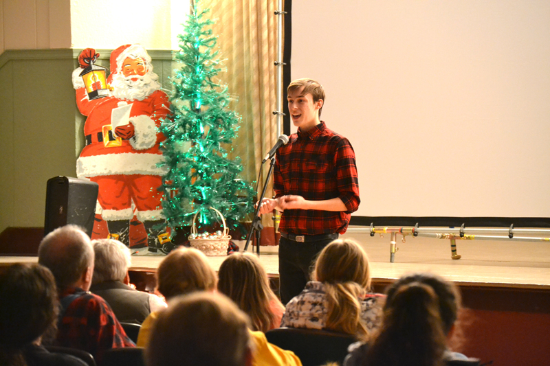 TRAVEL EDITION — Colfax High School senior Tate Russell was one of the featured storytellers in the Travel Edition of Truth Be Told at the Colfax Municipal Building auditorium December 30. — Photo by LeAnn R. Ralph