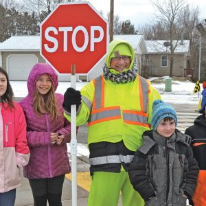 CROSSING GUARD WEEK — Students at Colfax Elementary made cards for Wendy Lausted, crossing guard, and four students presented them to her on January 17 in honor of Crossing Guard Week January 14 to January 18. Lausted has been a crossing guard for the Colfax school district for 21 years. From left: Olivia Steinbach, Alannah Smestuen, Wendy Lausted, Jack Whitwam and Braydyn Hiitola. —photo by LeAnn R. Ralph