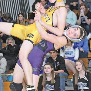 PICK AND THROW — Bulldogs' freshman wrestlers Ira Bialzik picked up and threw Ethan Duck of Cadott to the mat during the regional championship match at 126 pounds last Saturday. Bialzik won an 8-6 overtime decision against Duck to claim the regional gold. — photo by Shawn DeWitt