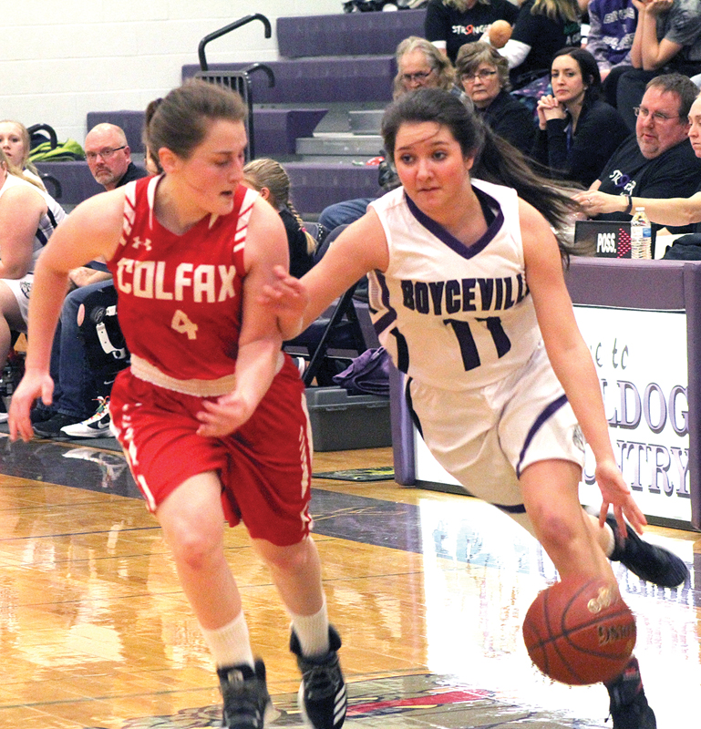 PUSH COMES TO SHOVE— Emma Ouellette (#11) got around defender Alyssa Dachel (#4) last Thursday evening, Februrary 14, to try and get to the hoop for two. Ouellette became frustrated during the contest after receiving her first foul. —photo by Amber Hayden
