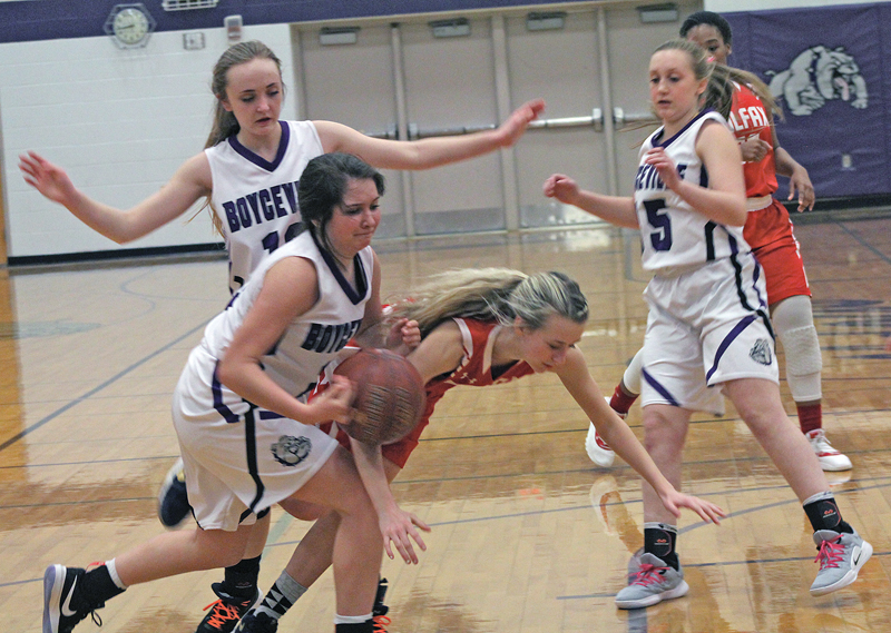 ALL FALL DOWN— Trying to protect the ball seemed futile for Jayna Bowe (#12) as Emma Ouellette (#11) reached for it as they both came toppling down to the floor during last Thursday's contest. The Vikings went on to win over Boyceville 58-21. —photo by Amber Hayden