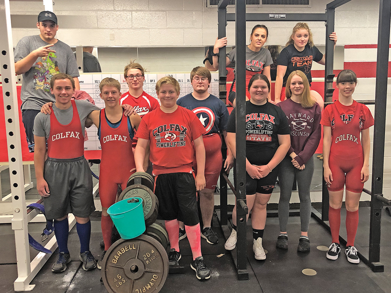 COLFAX POWERLIFTERS — Members of the 2018-19 Colfax powerlifting squad are shown in the above photograph. In front left to right are: Mykiah Young (hat), Dalton Bradford, Dalton Klukas, Austin Schindler, Mark Solberg, Koby Flodquist, Sydney Herrick, Addy Paulson and Jacelyn Olson. In the back on the black squat rack, from left to right are: Alexis Snider and Bailey Schlough. Missing from the picture are: JJ Charlesworth, Chase Aspengren, Asher Pecka and Austin Sundstrom. —photo submitted