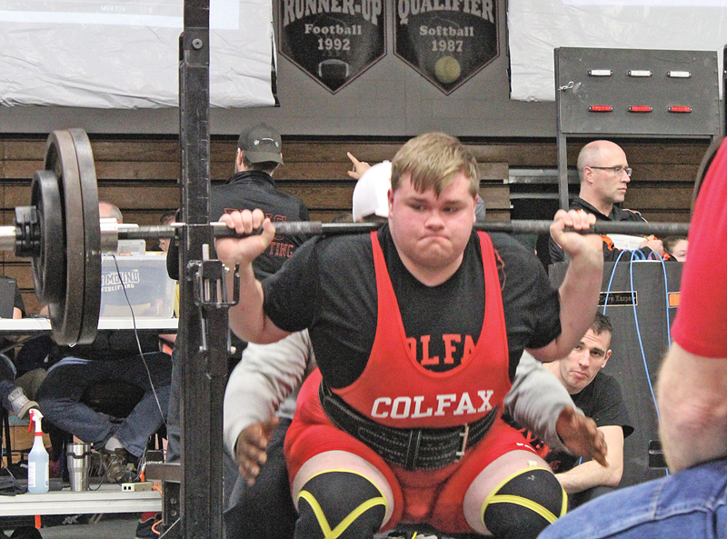 FOCUSING — Colfax's Chase Aspengren stayed focused throughout his first three lifts of the day finishing up with a 325-pound squat at a regional meet in Elk Mound on February 9. Aspengren still needs to add 125 pounds overall for powerlifting in order to make it to state. —photo by Amber Hayden