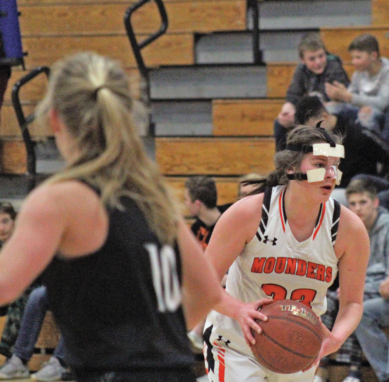 FACE MASK— Ever since Elk Mound's January 22 game against Colfax, Victoria Fasbender has had to learn how to play with a face mask due to a broken nose. Fasbender finished the night with six points in the Mounders 73-28 win over the Wolves. —photo by Amber Hayden