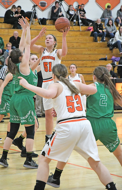 IN THE PAINT — Elk Mound's senior post player Morgan Radtke (#51) goes up for two of her 20 points during last Friday night's home contest against Eau Claire Regis. The Mounders' second-half rally fell short as the ninth-ranked Rambler girls won 62-57 in overtime. —photo by Shawn DeWitt
