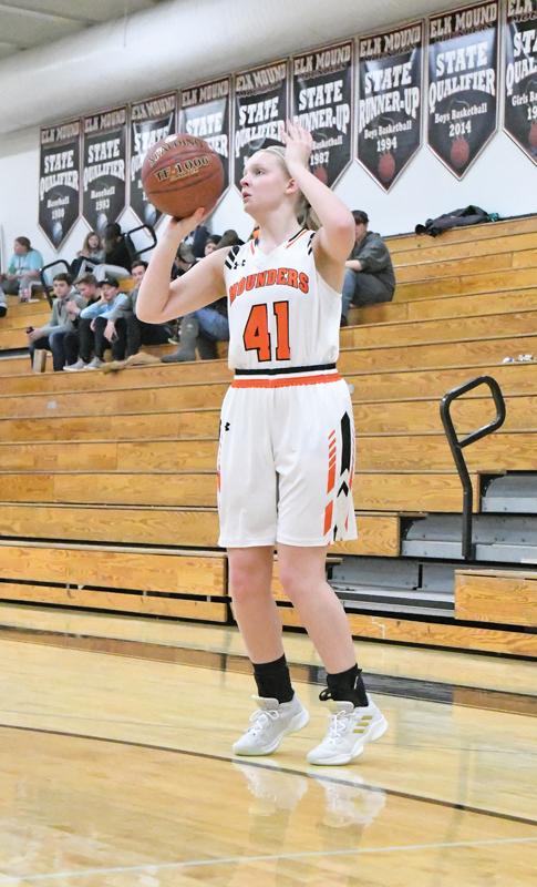 THREE-POINT ACE — Junior Sophie Cedarblade attempts a three-point shot during first-half action in the Mounders 62-57 overtime loss to Eau Claire Regis last Friday, February 1. Cedarblade finished with 12 points, all coming on four three-point baskets in the second half. —photo by Shawn DeWitt