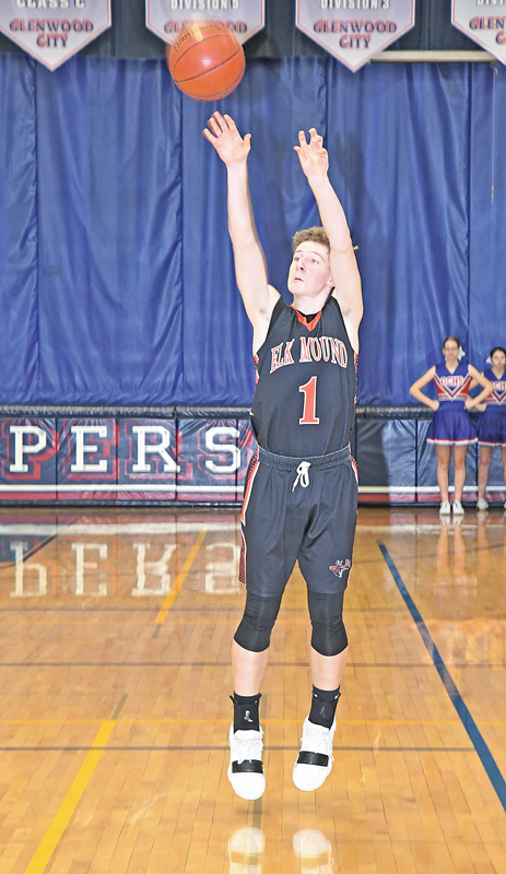 MOUNDERS' SOPHOMORE Ryan Bohl hit one of his two, first-half three-pointers during a boys' basketball contest in Glenwood City last Thursday. Bohl made a third triple in the second half and finished with nine points in the Mounders 50-45 loss to the Hilltoppers. —photo by Shawn DeWitt