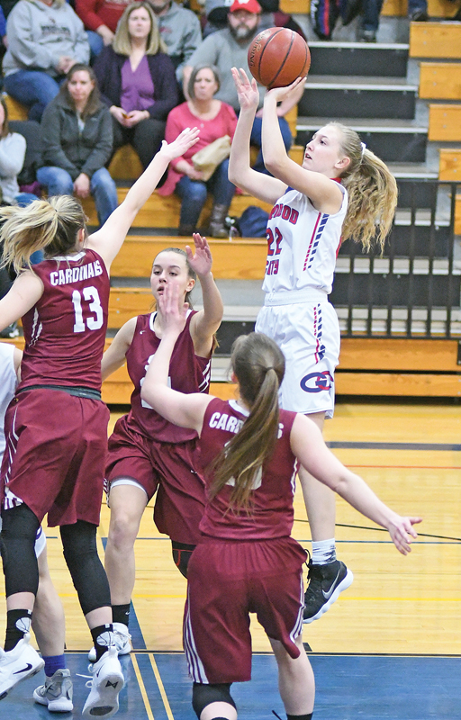 GLENWOOD CITY sophomore Maddie Oehlke took aim at the basketball when the Topper girls hosted Spring Valley last Thursday, February 14. Oehlke tallied ten points to help Glenwood City nip Spring Valley 52-50. —photo by Shawn DeWitt