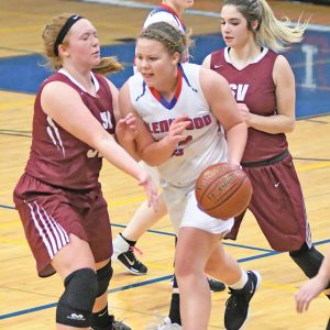 DRIBBLING through Spring Valley's full-court trap lat Thrusday night was Glenwood City guard Delanie Fayerweather (center). Glenwood City rallied to beat Spring Valley 52-50. —photo by Shawn DeWitt