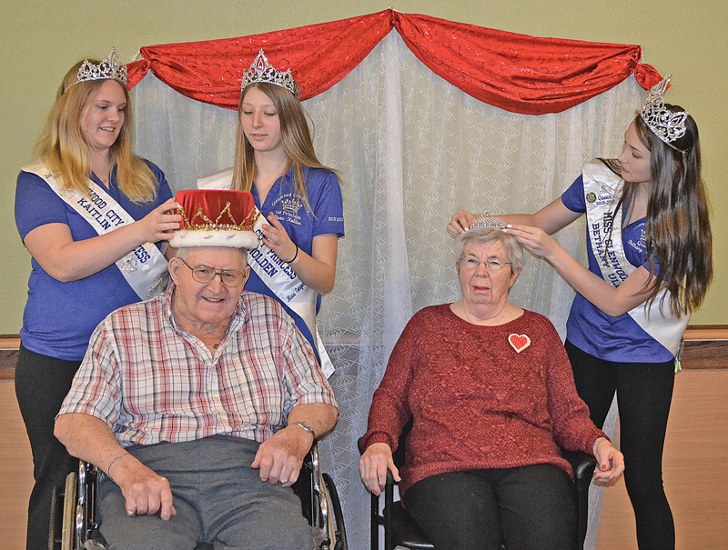 VALENTINE'S DAY ROYALTY CROWNED — The 2018-19 Miss Glenwood City court did the honors of crowning Glenhaven's 2019 Valentine's Day court last Thursday, February 14. In back, from left to right, are Miss Glenwood City Princesses Kaitlyn Lee and Alexa Holden placed the king's crown on Orville Wittmer (front left) while Miss Glenwood City Bethany Ullom arranged the queen's tiara on the head of Gladys Best (front right). —photo by Carole Schurtz