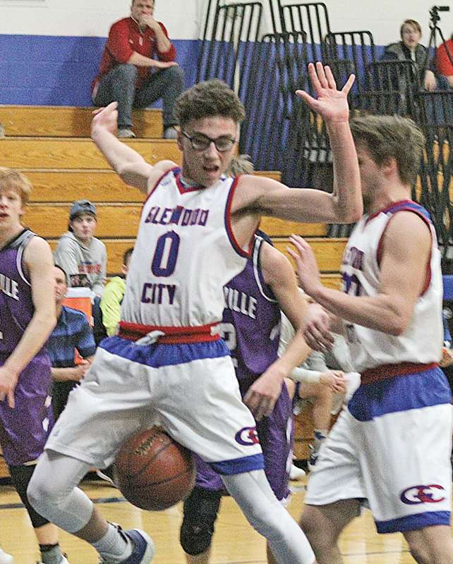 WHOOPS - Brandyn Hallquist (#0) keeps his hands back as the ball escapes from a rebound by Cade Klefstad (#34). Hallquist had a career high of 24 points against the Boyceville Bulldogs last Monday evening, February 18. —photo by Amber Hayden