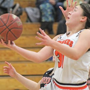 ONE HANDED — Elk Mound's Hailey Blaskowski went up for the basket with the ball in one hand as she put in two of her six points against the Viroqua Blackhawks in the first round of the 2019 WIAA Division 3 girls' basketball tournament February 19. Elk Mound went on to win by 40 points to advance to play Westby, whom they beat as well. —photo by Amber Hayden