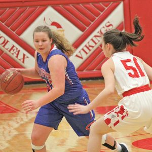 TOUGH NIGHT - Delanie Fayerweather (#32) works her way around Madison Barstad (#50) during the second round of playoffs for Glenwood City. Fayerweather left the game with seven minutes remaining in the first half after twisting her knee. —photo by Amber Hayden