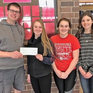 THE COLFAX HIGH SCHOOL student council donated $500 to the Colfax Municipal Building Restoration Group. The money was earned during the school's annual winter carnival coin drive. Pictured from left to right are: Troy Knutson (CMBRG representative), Hailey Prince, Alyssa Dachel and McKenna Yingst. The girls are the student council officers. —photo submitted