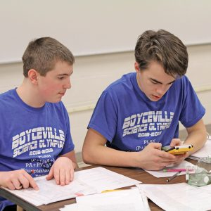 MAKING CALCULATIONS — Parker Coombs and Peter Wheeldon are shown competing in the event, Thermodynamics. The students earned 1st place. —photo by Steve Duerst