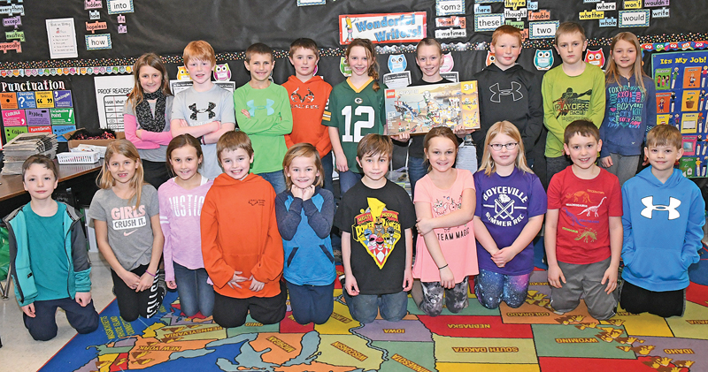 MEMBERS OF MRS. BIGNELL'S Third Grade class gather for a class picture with Jase Hoyt who received a gift from Santa's Helper who heart was touched by Hoyt's letter to Santa asking Santa to make his grandpa feel better. Hoyt is pictures in the right back row holding the special gift. —photo by Shawn DeWitt
