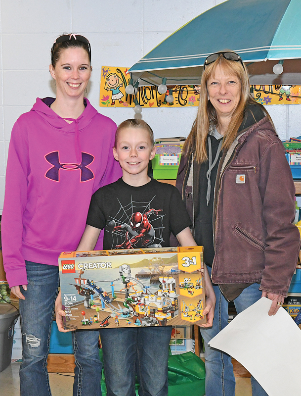 JASE HOYT with his mother Tara Lain, left and grandmother Lynn Lain and his special gift. —photo by Shawn DeWitt