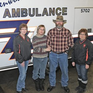 DONATION PRESENTED — Glenwood City ambulance co-directors Julie Lee (left) and Charl Draxler (right) presented Jodi and Dennis Hall with a check from a fundraiser the Glenwood City Ambulance personnel hosted on Saturday, January 26 to benefit Jodi Hall. The event featured a soup and sandwich luncheon, a bake sale and silent auction raised funds to help Jodi Hall with her medical expenses as she received treatment for pancreatic cancer. Her husband Dennis is an EMT with the Glenwood City service. The Glen Hills Lions Club, local boys scout troop and the Halls' church helped with the benefit. —photo by Shawn DeWitt