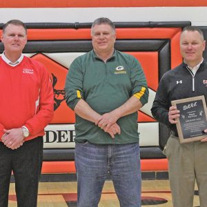 THANK YOU — Colfax and Elk Mound Superintendents Bill Yingst (left) and Eric Wright (right) presented Rod Dicus (center) with a plaque during halftime of the Elk Mound versus Colfax boys' basketball game Monday evening, February 11 in Elk Mound. Dicus retired recently from the Dunn County Sheriff's Office where he served as the D.A.R.E. officer for the two school districts. —photo by Amber Hayden