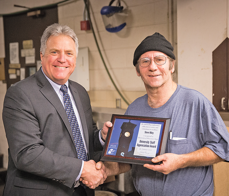 Steve Riley, right, receives the University Staff Employee Appreciation Award for January from Chancellor Bob Meyer. —photo submitted