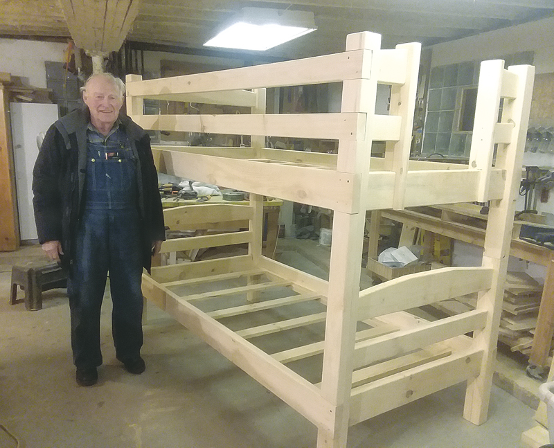 BEDS 4 KIDS — Herb Tallman of Sand Creek has been building bunk beds and single beds for the new non-profit organization, Beds 4 Kids, founded by Robyn and Richard Lee of New Auburn and Chelsea Reese of Chippewa Falls. Beds 4 Kids supplies beds and bedding to families who have taken in children for foster care or kinship care in Dunn County, Chippewa County and Barron County. Robyn Lee says Beds 4 Kids is hoping to find more volunteers to help with building the beds and delivering them. —photo submitted