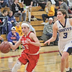 TIME TO SHINE— Viking's guard, Morgan Schleusner (#10) was the bright spot for Colfax as she beat her way down the court for two with St. Croix Falls defender Josey Kahl (#3) chasing her down. Schleusner finished up to lead Colfax with 12 of her 17 points coming from the foul line. —photo by Amber Hayden