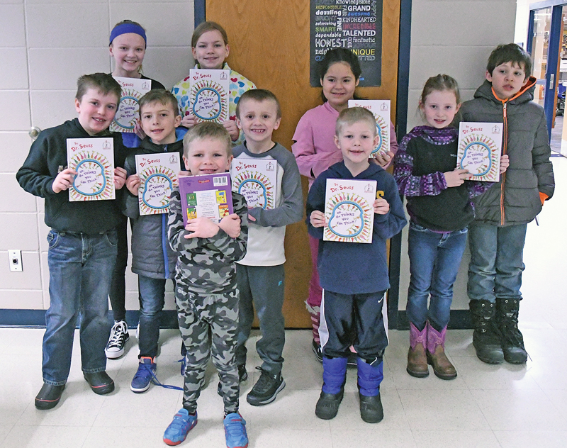 """TEN LUCKY WINNERS had their names drawn to receive a free Dr. Seuss book during the """"Muffins and Juice with Dr. Seuss"""" kickoff to National Reading Month at the Glenwood City Elementary last Friday morning, March 1. Winners, pictured above, in front row (L to R) are: Johnny Logghe, Sawyer Brite, Odin Teigen, Connor Ohman and Nolan Standaert. Back row (L to R): Kylie Ohmna, Cecelia Slayton, Mia Alvarez, Haylee Deiss and Gabe Kohler. —photo by Shawn DeWitt"""