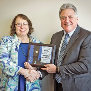 HONORED — Bonni Falkner (left) receives the University Staff Employee Appreciation Award for March from Chancellor Bob Meyer. —photo submitted