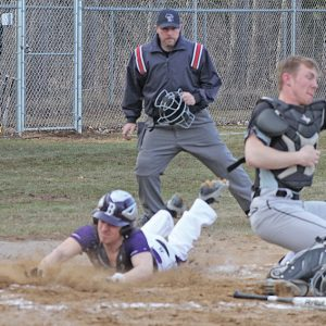 SAFE — Nick Litomsky (#7) slide safely home for a run in the second inning after beating the tag from the Elmwood/Plum City catcher. Boyceville sat at 3-0 in the D-SC after the 12-2 victory over the Wolves on April 16. —photo by Amber Hayden