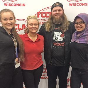 GOLD-MEDAL WINNERS — Boyceville FCCLA members posed with Chris Kroeze, Barron native and runner-up of season 15 of The Voice, during the FCCLA State Leadership Conference in Wisconsin Dells April 8-10. Pictured from left to right are: LaRissa Krueger, Maggie Wyss, Chris Kroeze, and Ade Harpil. All three of Boyceville's state participants received gold medals in their competition categories. —photo submitted
