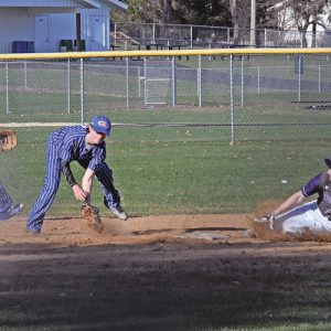 STEALING SECOND — Boyceville's Logan Knudtson successfully stole second base when the Bulldogs hosted Glenwood City last Tuesday, April 23 in a conference baseball game. The Toppers Bryce Wickman (center) fielded the wide threw on the play while teammated Gavin Janson (left) backed up the toss. Boyceville went on to win the game 10-2. —photo by Shawn DeWitt