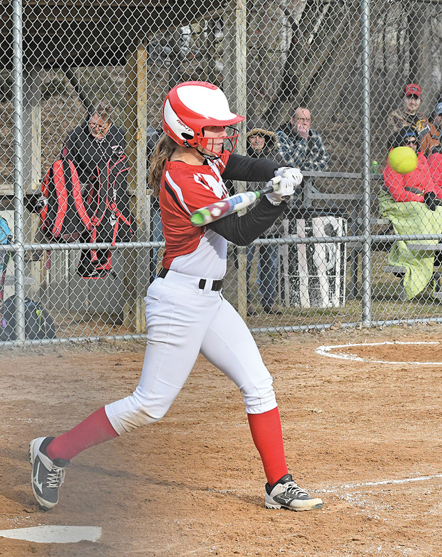 BASE HIT — The Vikings' Taylor Irwin drove this pitch to the outfield for her only hit in a road game in Elmnwood last Tuesday, April 9 against the Elmwood/Plum City Wolves. Colfax lost the season opening contest 7 to 5. —photo by Shawn DeWitt